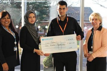 Staff of Barnfield College present a cheque to Luton Foodbank